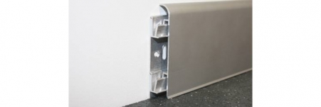 This profile is anodised Aluminium skirting which is easy to install and allows you to cover and protect low running cables around the perimeter